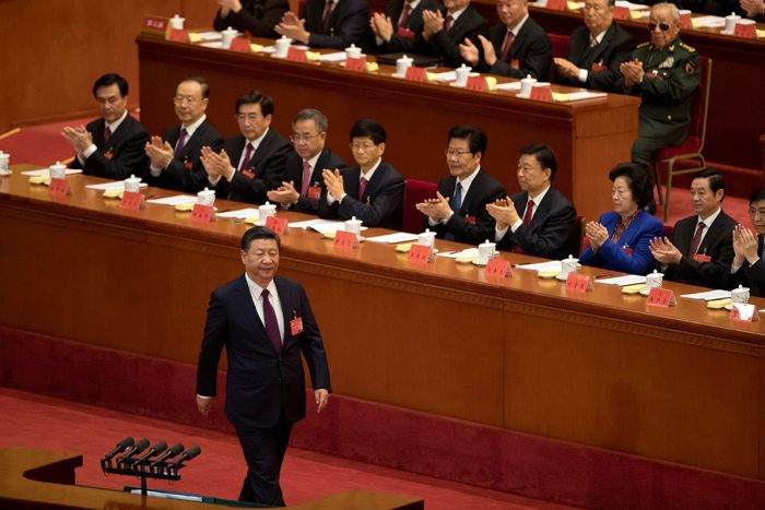 Chinese President Xi Jinping is applauded as he walks to the podium to deliver a speech in front of party members.