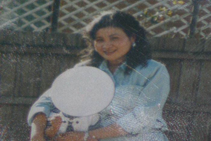 And old photo of Ranny Yun standing near a fence.
