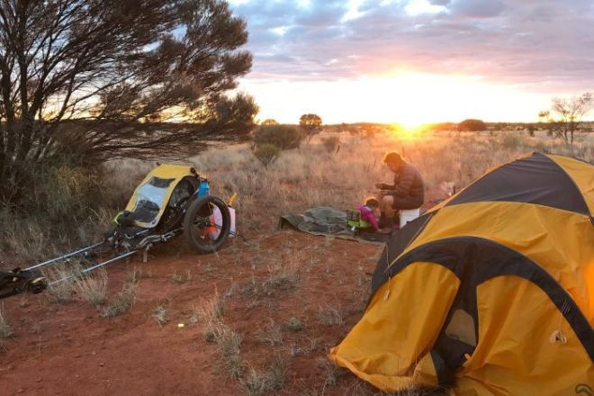 The sun sets as the Jones make camp in the outback.