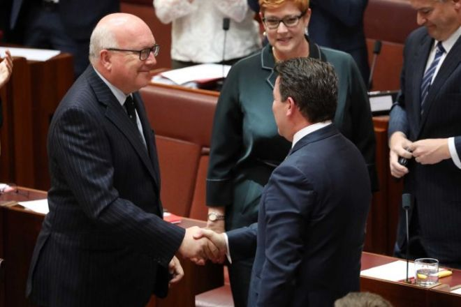 George Brandis and Dean Smith shake hands after the same-sex marriage bill passes Senate.