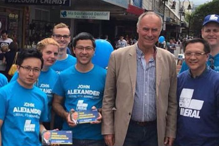 John Alexander campaigns with Mr Xu (left).