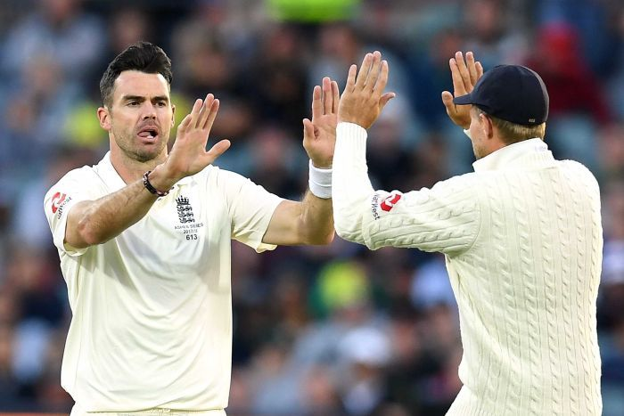 James Anderson and Joe Root give a high ten after Anderson took a wicket.