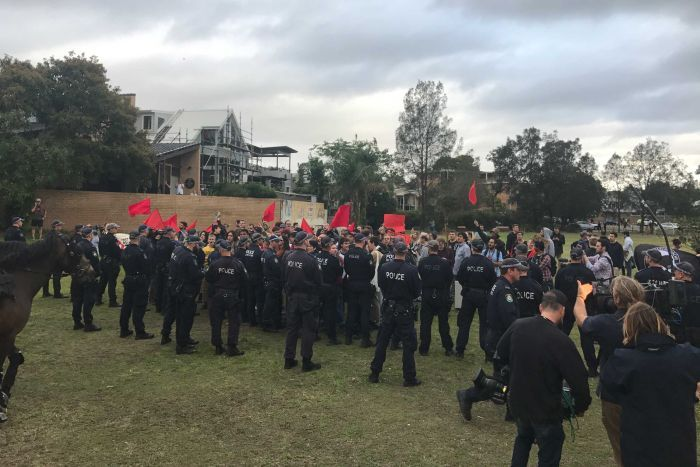 Police surround protesters