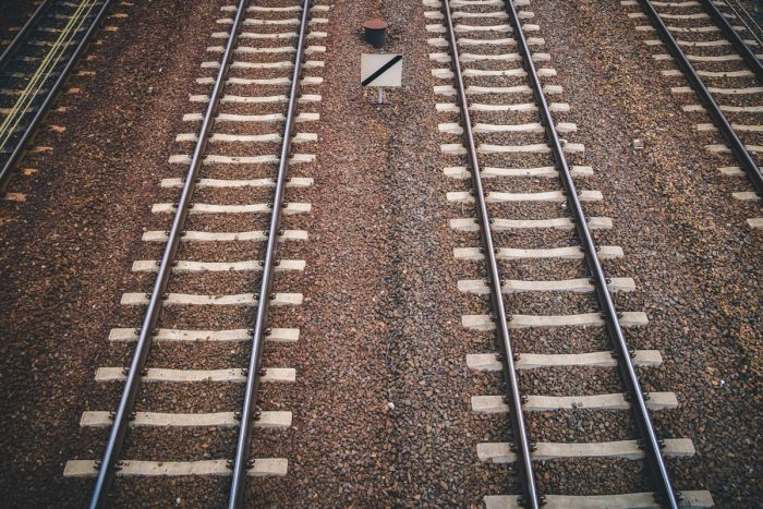 Two train tracks running parallel.