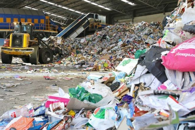 A tractor separates material for recycling at Re Group's Hume facility.