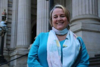 ICAN cofounder Dimity Hawkins outside Victoria's Parliament.