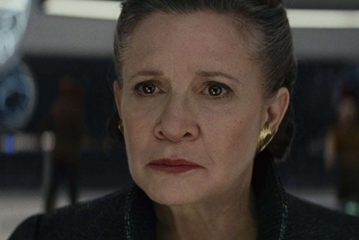 A close of of Carrie Fisher in Star Wars The Last Jedi, looking serious.