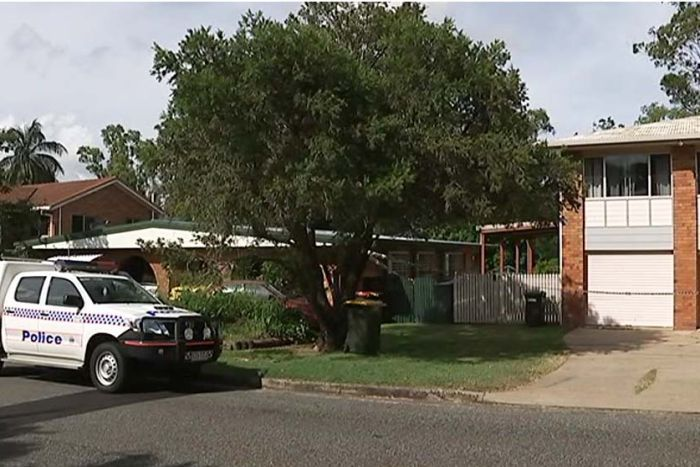 Police car and tape at a house in Rockhampton where a 53-year-old woman was found dead.