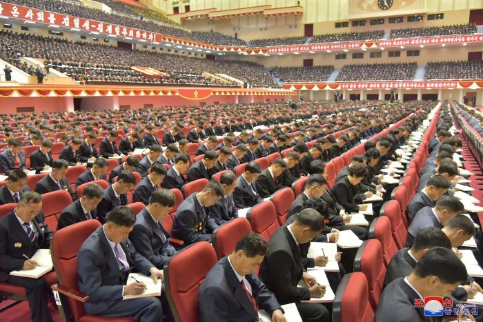 Attendees take notes at the Workers' Party of Korea conference