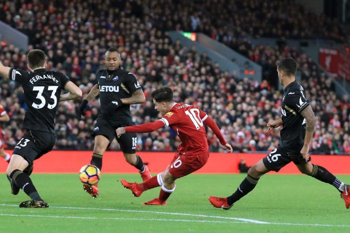 Liverpool's Philippe Coutinho scores against Swansea at Anfield on December 26, 2017.