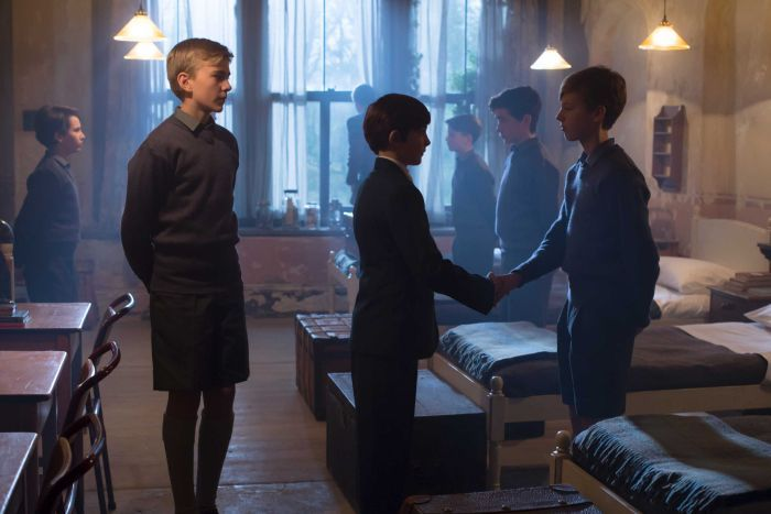A young Prince Charles (played by Julian Baring) meets his new classmates at Gordonston in Scotland.