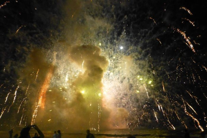 Terrigal fireworks erupt everywhere after barge caught alight
