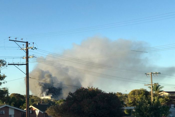 Smoke billows from a meat processing factory fire.