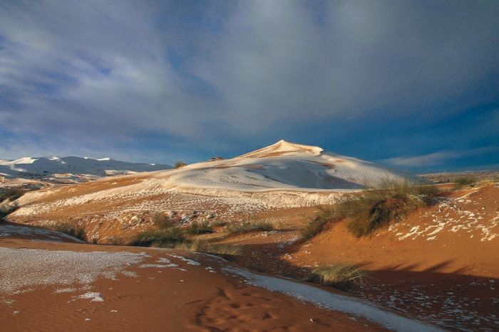 Snow falls on the Sahara Desert after a freak storm hits the area.