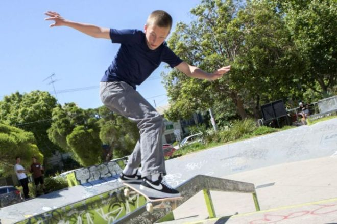 Young skateboarder Keegan Palmer, 14, does a trick.