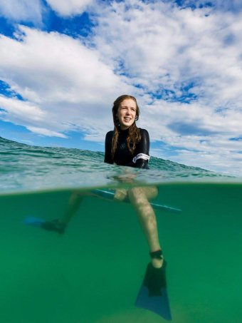 Bodyboarder Millie Chalker in the water, shot showing flippers and board.