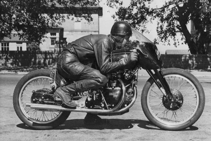Motorcyclist Jack Ehret with his Vincent Black Lightning in a simulation of a racing seating position in 1952.