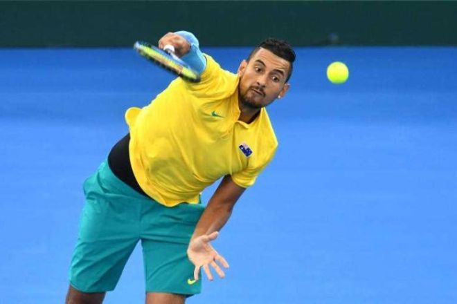 Nick Kyrgios is seen serving from front-on.
