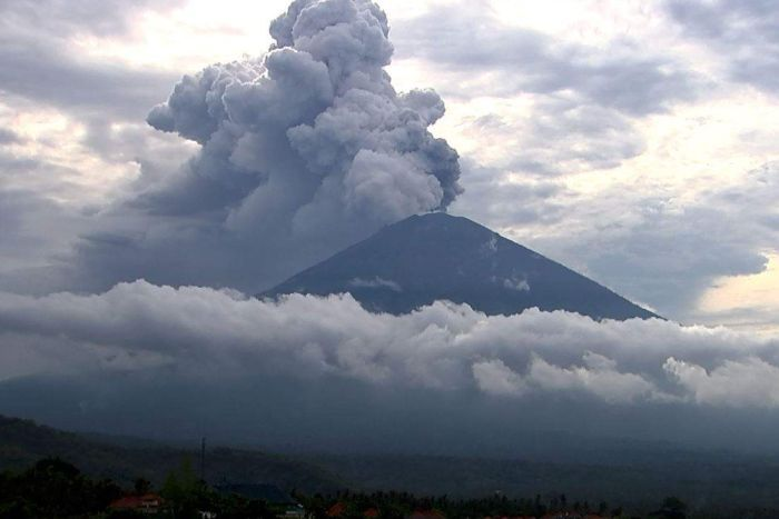 Plumes of smoke comes from the top of Mt Agung.