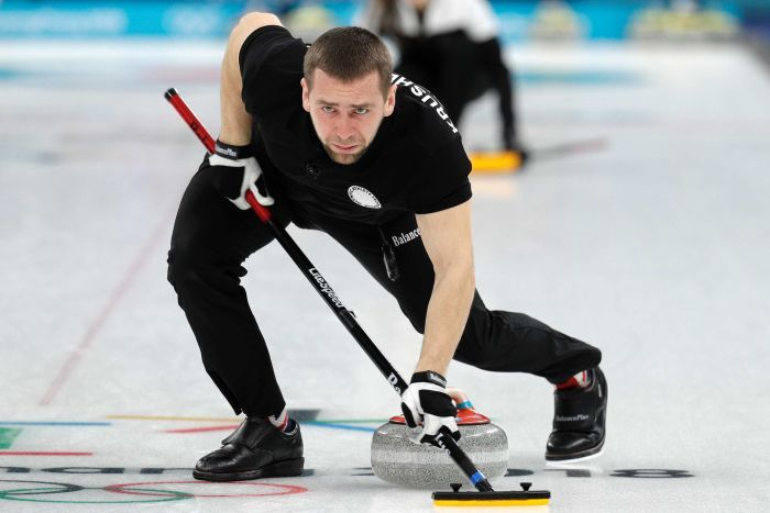 Olympic Athlete from Russia Alexander Krushelnitsky sweeps the ice during the mixed doubles curling at Pyeongchang.