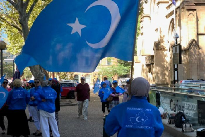 Uighur women at protest against China's mass incarceration