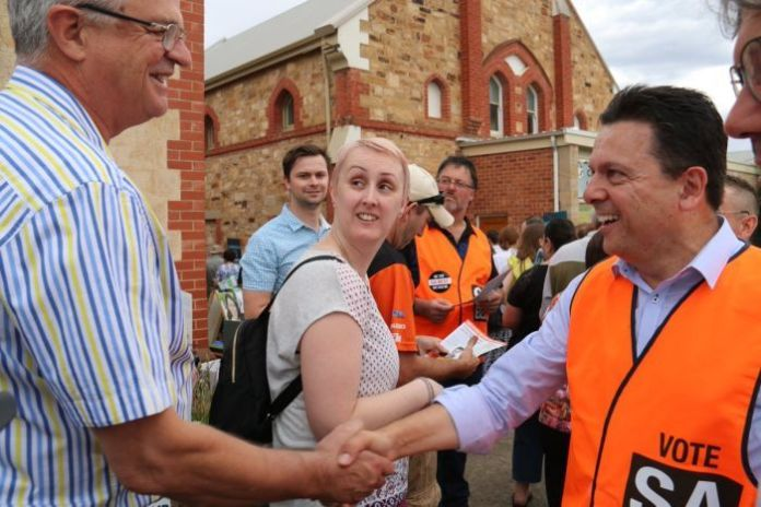 Nick Xenophon shakes hands with a voter.