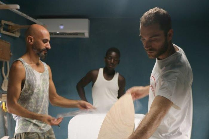 Hadi Beydoun, Paul Abbas and a local worker craft boards in their Abidjan factory.