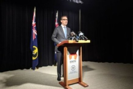 Steven Marshall at a podium for a news conference.