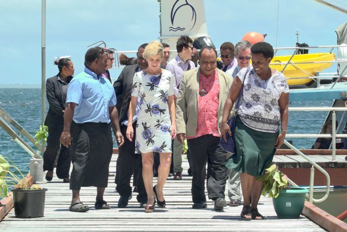 Image of Australian Foreign Minister Julie Bishop walking with a group of people, including PNG Foreign Minister Rimbink Pato