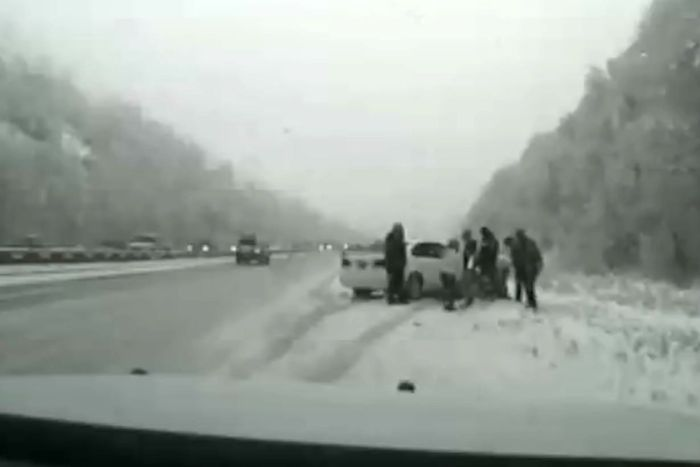 Bystanders rushed to the aid of Sergeant Brenchley on the side of the highway