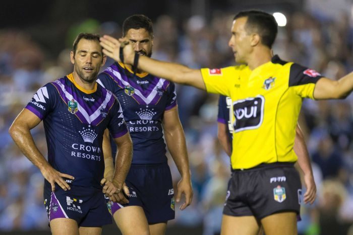 Melbourne Storm captain Cameron Smith looks frustrated as a referee blows a pently