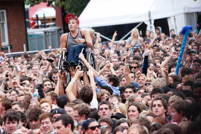 Dylan Alcott crowd-surfing at Laneway Festival.