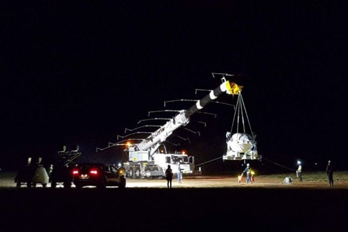 A space balloon being lifted from a crane in Alice Springs.