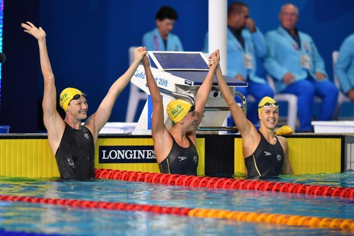 Cate Campbell of Australia celebrates with team mates Holly Barratt and Madeline Groves.
