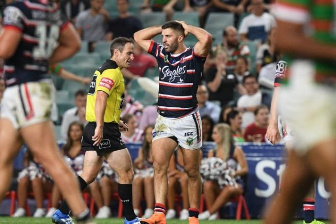 Sydney Roosters fullback James Tedesco holds his hands to his head
