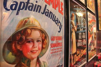 A movie poster featuring Shirley Temple.
