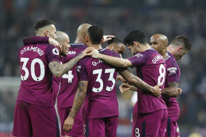 Manchester City players celebrate scoring goal at Wembley