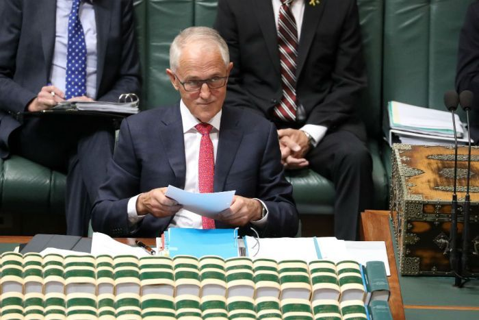 Malcolm Turnbull looks up from papers in Question Time