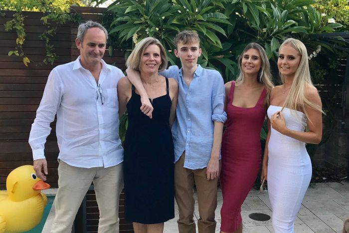 Sandra Moore with her family after she finished a melanoma clinical trial