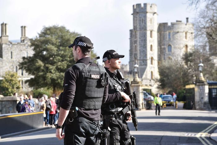 Armed officers stand near Windsor Castle