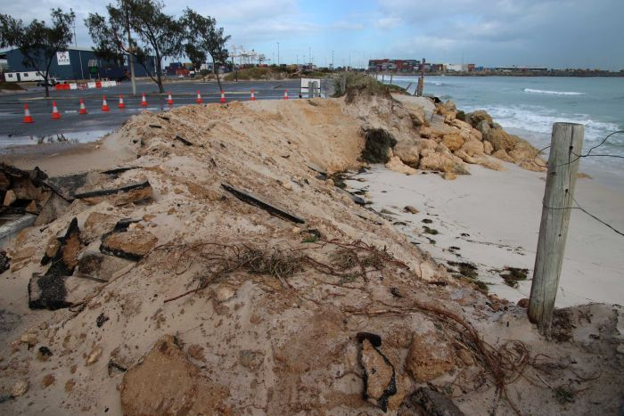 Erosion at Port Beach carpark Fremantle with witches' hats cordoning off parts of the bitumen.