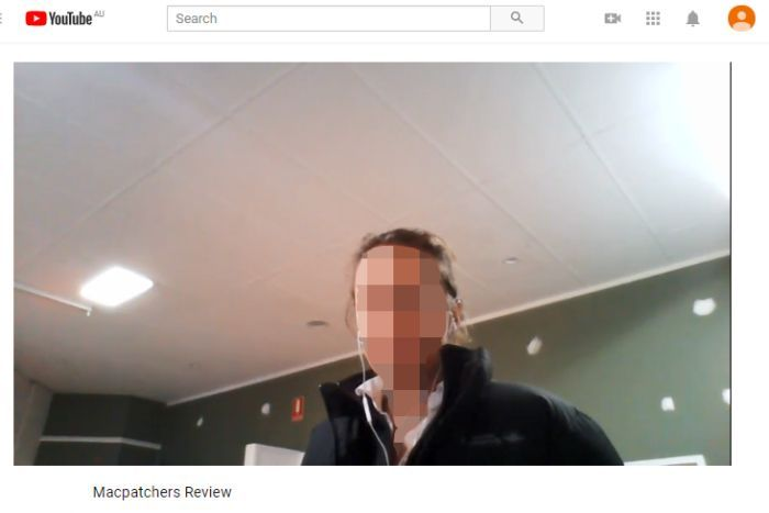 Screengrab of Youtube, with a woman, face pixelated, sitting in her home.