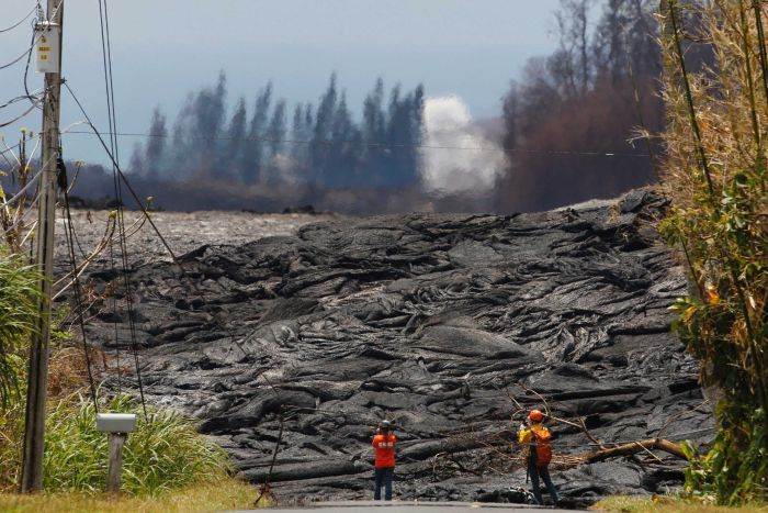 USGS personnel monitor and record lava fissures from a volcano eruption in Hawaii.