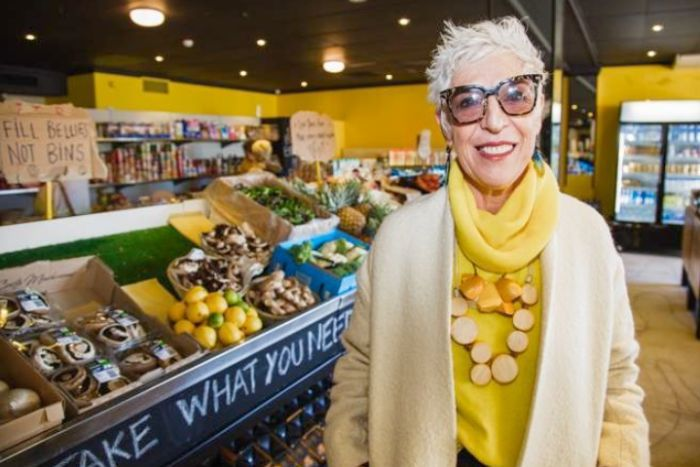 Ronni Kahn stands in a food market.
