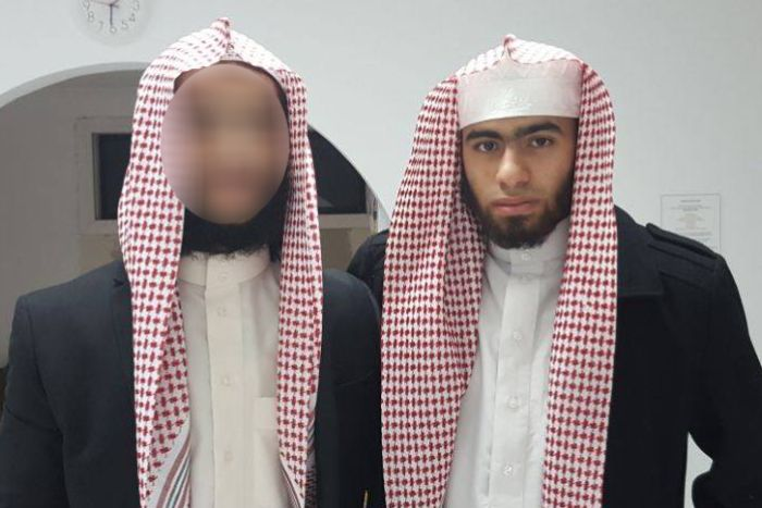 Two young men with Arab scarves.