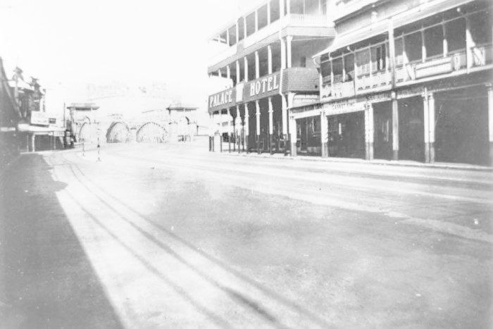 Historic black and white photo of the Palace Hotel and Victoria Bridge.