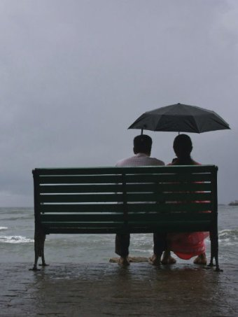 Kerala couple sitting on a bench India