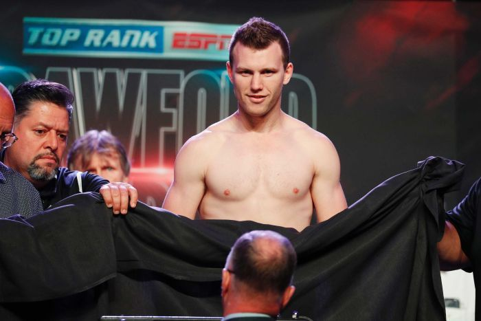 A sheet is used to cover Jeff Horn, who weighed in naked