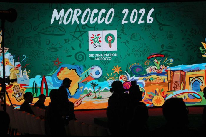 A background with the Morocco 2026 logo