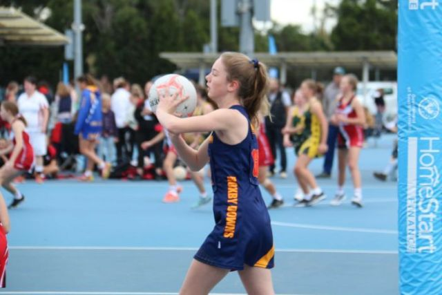 Olivia makes a pass forward with the netball.